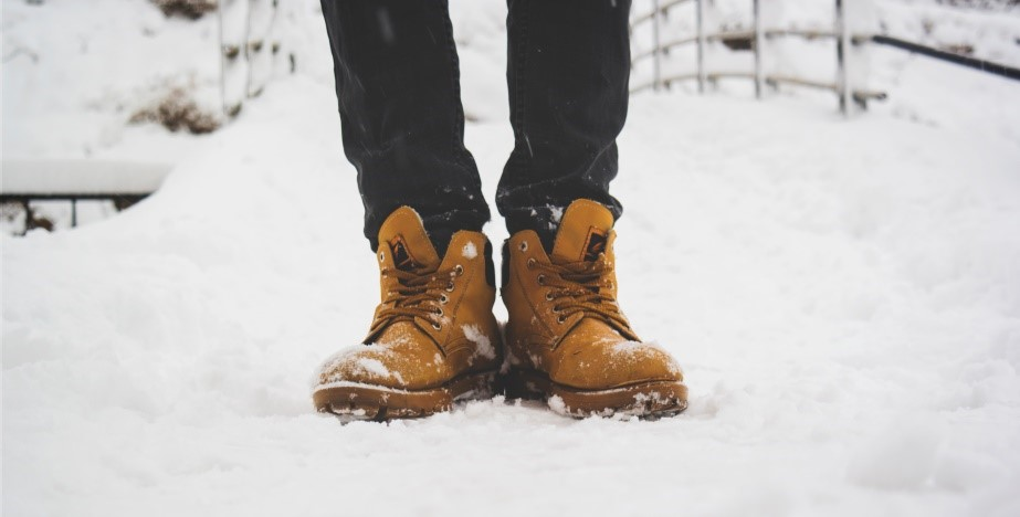 photo of someone's feet in the snow