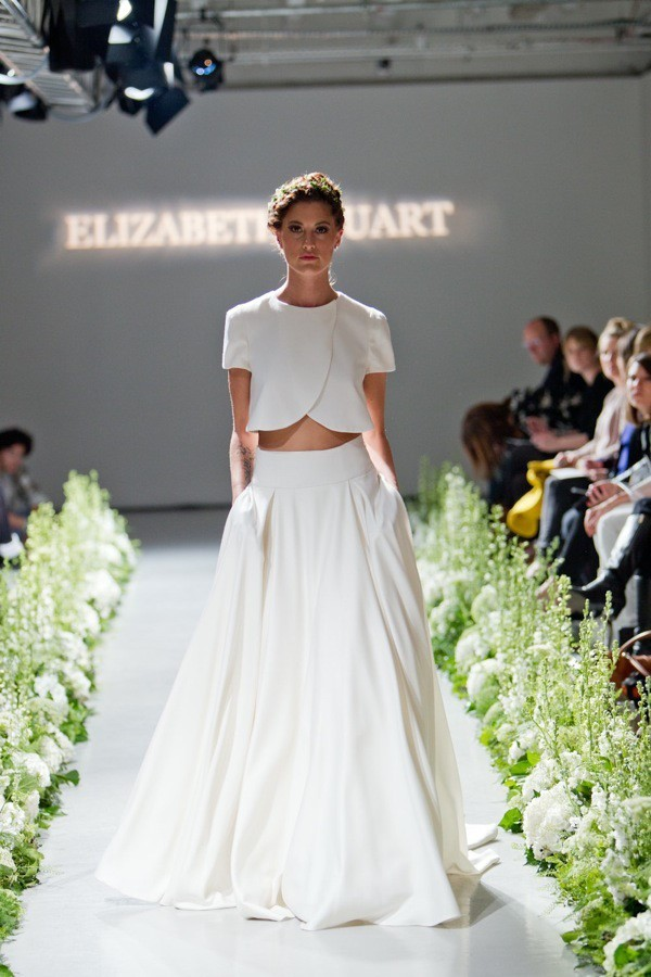 photo of a woman wearing a wedding dress on a runway