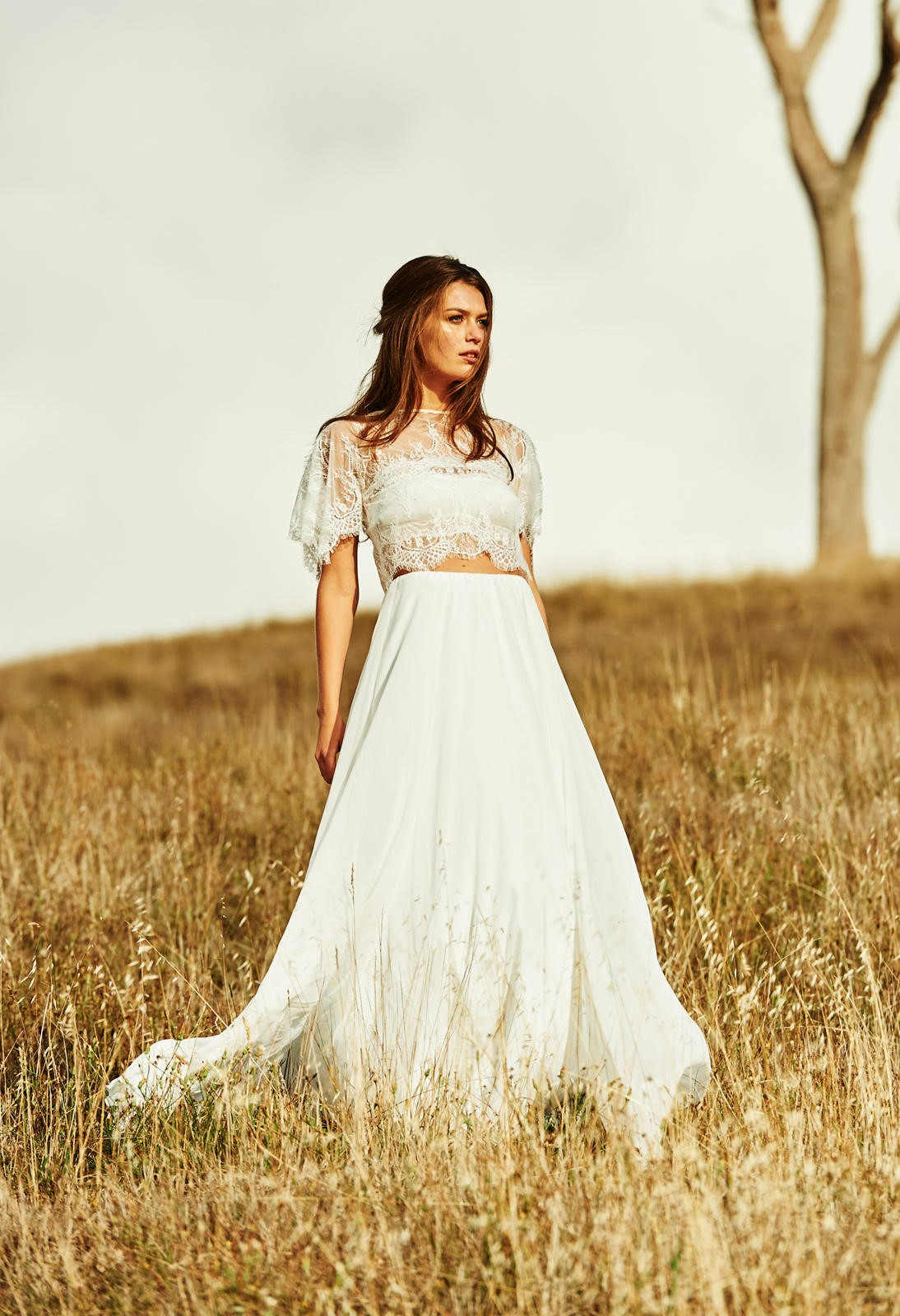 photo of a woman wearing a wedding dress outdoors