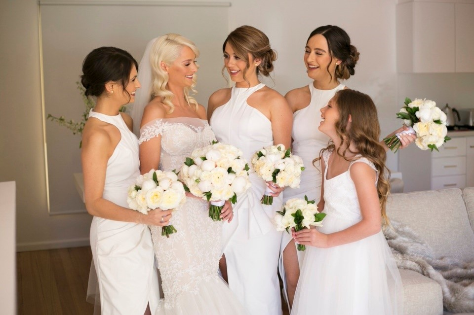 photo of a bride with her bridesmaids