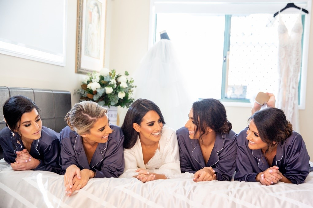 photo of a bride and her bridesmaids getting ready