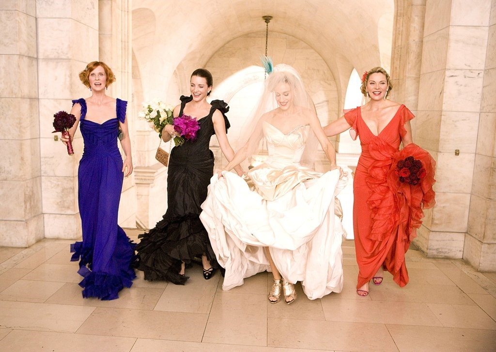 photo of a bride and her bridesmaids inside a building