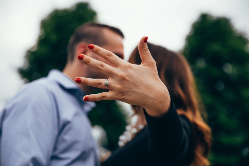 photo of a couple together with a ring