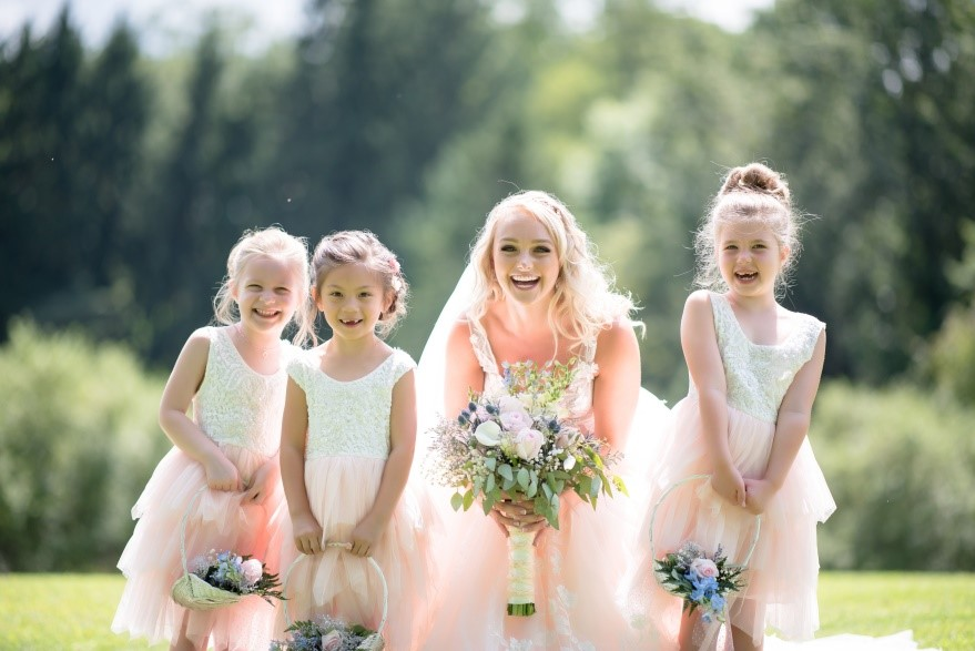 photo of a bride and flowergirls